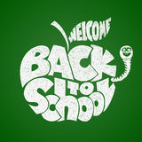 Back to school. Chalk lettering inscribed in the apple shape Royalty Free Stock Photo