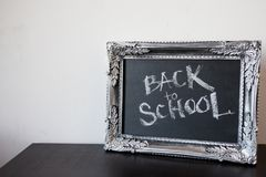 Back to school, chalk in a vintage frame. Text on chalkboard royalty free stock photography