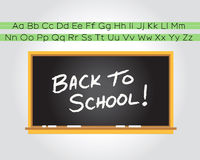 Back to school chalkboard. Illustration of a chalkboard on a wall with handwritten Back To School! & primary alphabet above Royalty Free Stock Photography