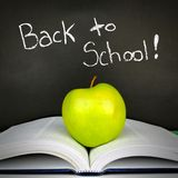 Back to School chalkboard with book and apple Stock Photography
