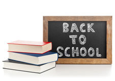 Back to school chalkboard  with books Stock Photos