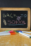 Back to school on chalkboard Royalty Free Stock Image