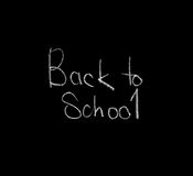 Back to School on chalkboard, isolated, black Stock Photos