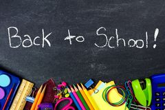 Back to School on chalkboard with school supplies border Royalty Free Stock Photos
