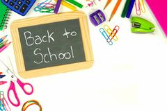 Back To School chalkboard with school supplies border Stock Images