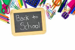 Back To School chalkboard with school supplies border Royalty Free Stock Photos