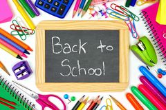Back To School chalkboard with school supplies frame Stock Photos