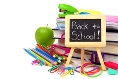 Back to School on chalkboard with school supplies over white Royalty Free Stock Images