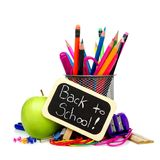 Back to School chalkboard tag with school supplies over white Royalty Free Stock Photos