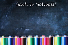 Back to School Chalkboard Texture Background with Colored Pencil Royalty Free Stock Images