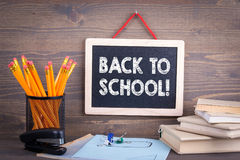Back to school. Chalkboard on a wooden background royalty free stock images