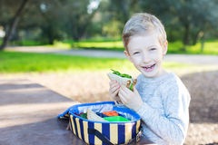 Back to school. Cheerful schoolboy eating healthy lunch during recess at school Stock Images