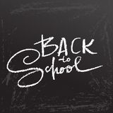 Back to school. Clalk lettering on blackboard surface. Typography poster. Vector illustration. Back to school. Clalk lettering on blackboard surface. Typography Stock Images