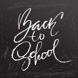 Back to school. Clalk lettering on blackboard surface. Typography poster. Vector illustration. Back to school. Clalk lettering on blackboard surface. Typography Royalty Free Stock Photography