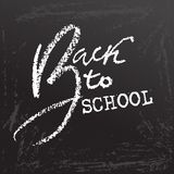 Back to school. Clalk lettering on blackboard surface. Typography poster. Vector illustration. Stock Image