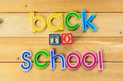 Back to school. Close up arrangement of `Back to School` alphabet on wooden background Royalty Free Stock Photos