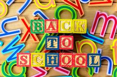 Back to school. Close up arrangement of `Back to School` alphabet on wooden background Stock Photo