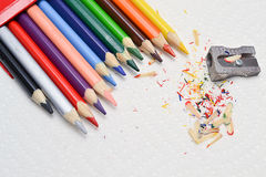 Back to school. Closeup on drawing colorful pencils and sharpener on a white paper towel stock images