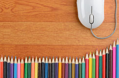 Color Pencils and a Computer Mouse Stock Photo