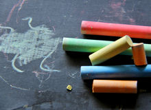 Back to school. School colored chalk on a miniature dark school board Royalty Free Stock Photography