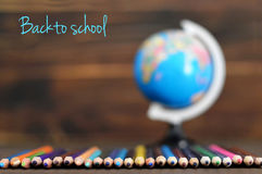 Back to school: Colored pencils and a globe stock photo