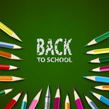 Back to school with colored pencils on green background Stock Photo