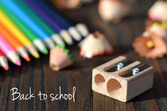 Back to school: Colored pencils and sharpener Stock Images