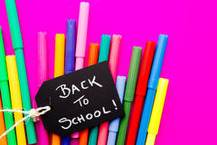 Back to School - colored pens on pink background. Back to School - multi colored pens on pink background Royalty Free Stock Photo