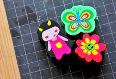 Back to school. Colorful school  erasers on a dark blackboard Royalty Free Stock Photography