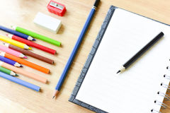 Back to school. Colorful Office and study art stationery objects. On wood table with open notebook.Kid love to drowing Stock Image