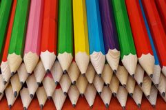 Back to school colorful pencils background. Colorful wooden black pencils are piled high for back to school Royalty Free Stock Images