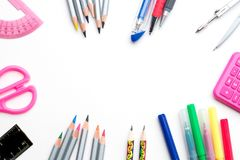 Back to school. Colorful school stationery framing isolated on white background - copyspace top view Stock Photos