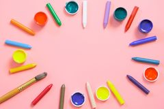 Back to school. Colorful wax crayons, paints for creative on pink. Copy space. Top view. Back to school. Colorful wax crayons, paints for creative on pastel pink stock photo