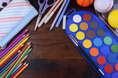 Back to School with coloring pencils paints. Stock Photo