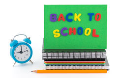 Back to school concept. Alarm clock,  notebook  and pencil Royalty Free Stock Photo