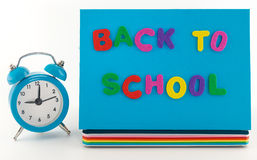 Back to school concept. Alarm clock,  notebook  and pencil Stock Image