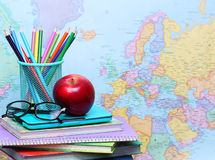 Back to school concept. An apple, colored pencils and glasses Royalty Free Stock Image