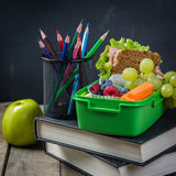 Back to school concept. Healthy lunch and stationary Stock Photo