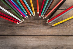 Back to school concept background with colored pencils on wooden table Royalty Free Stock Images