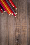 Back to school concept background with colored pencils on wooden table. Copy space Royalty Free Stock Photos