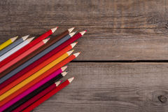 Back to school concept background with colored pencils on wooden table. Copy space Royalty Free Stock Photography