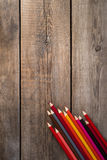 Back to school concept background with colored pencils on wooden table. Copy space Stock Photos