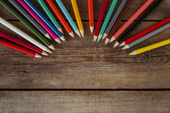 Back to school concept background with colored pencils on wooden table, flat Royalty Free Stock Photo