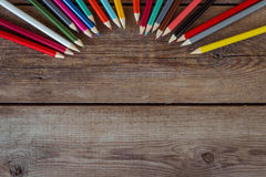 Back to school concept background with colored pencils on wooden table Stock Image