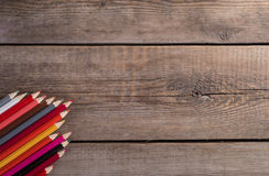 Back to school concept background with colored pencils on wooden table. Copy space Stock Photo