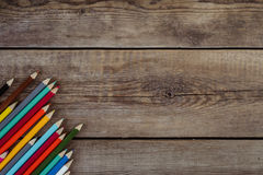 Back to school concept background with colored pencils on wooden table, flat lay Royalty Free Stock Photos