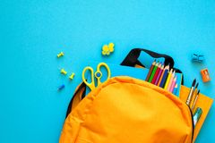 Back to school concept. Backpack with school supplies. Top view. Copy space. Toned. Back to school concept. Backpack with school supplies. Top view. Copy space royalty free stock photos