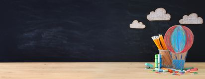 Back to school concept banner. hot air ballon and pencils in front of classroom blackboard. royalty free stock images