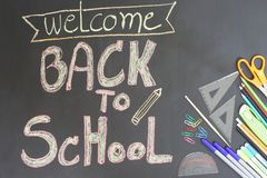 Back to School concept on the black floor top view royalty free stock photo