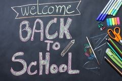 Back to School concept on the black floor top view stock images